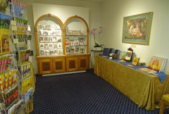Self-Realization Fellowship magazines and pictures of Yogananda on display in the Temple bookroom