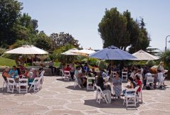 Young Adults eating lunch on the courtyard during the young adult retreat